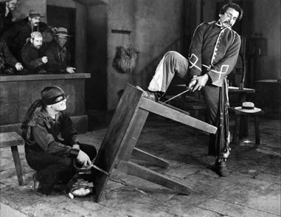 the-mark-of-zorro-douglas-fairbanks-duel-sword-stuck-in-table